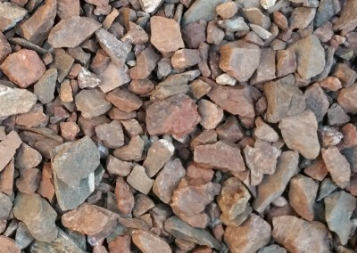 "Desert Spice 1/2"" screened landscape rock"